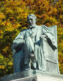 Statue of A.D. White set against autumn foliage